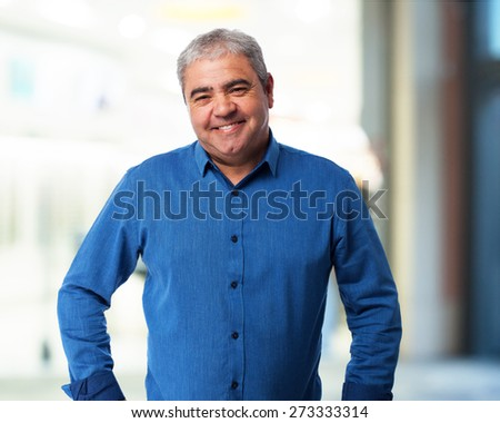 portrait of a mature handsome man smiling - stock photo