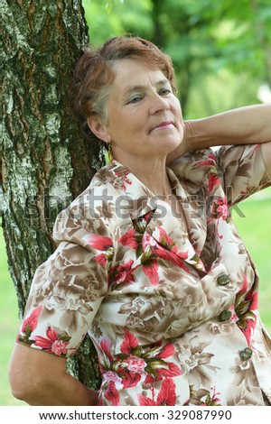 Portrait of a mature lady enjoying summer outdoors