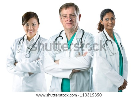 Portrait of a Mature male doctor standing with his team. - stock photo
