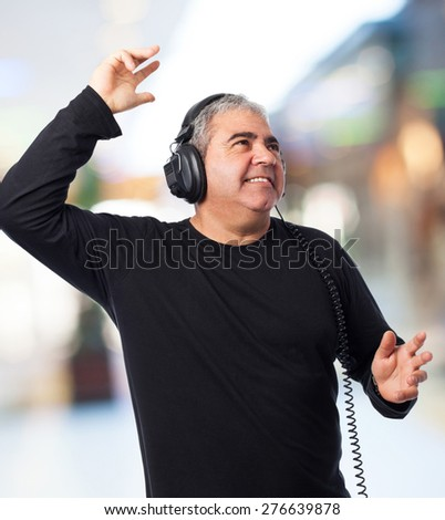 portrait of a mature man listening to music
