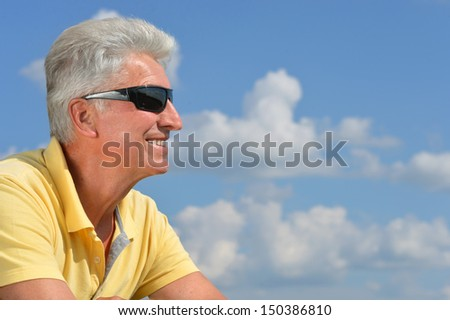 portrait of a  mature man on the background of sky