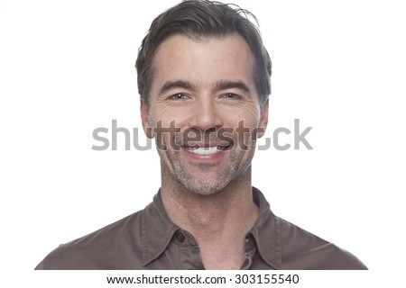 Portrait Of A Mature Man Smiling At The Camera Isolated On White - stock photo