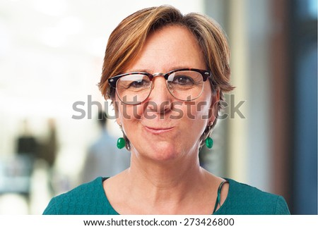 portrait of a mature woman doing a funny grimace - stock photo