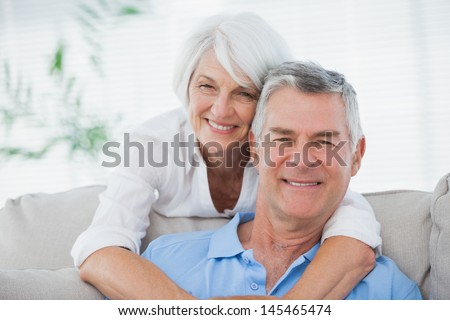 Portrait of a mature woman hugging husband  - stock photo