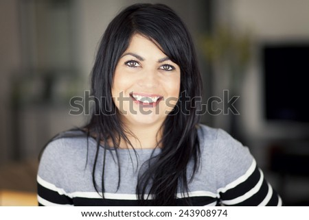 Portrait Of A Mature Woman smiling at the camera - stock photo