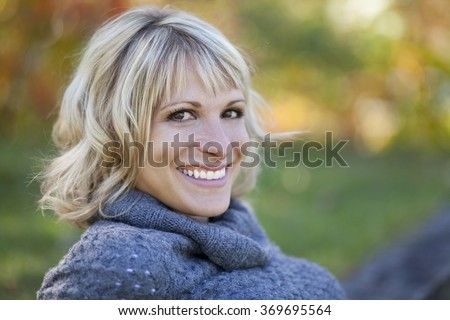 Portrait Of A Mature Woman Smiling At The Park - stock photo