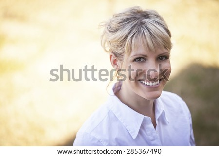 Portrait Of A Mature Woman Smiling Outside - stock photo