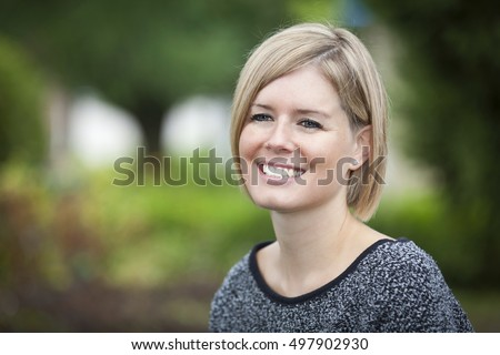 Portrait Of A Mature Woman Smiling. Outside.