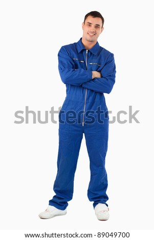 Portrait of a mechanic with the arms crossed against a white background