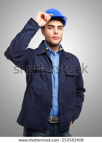 Portrait of a mechanical worker holding his helmet - stock photo