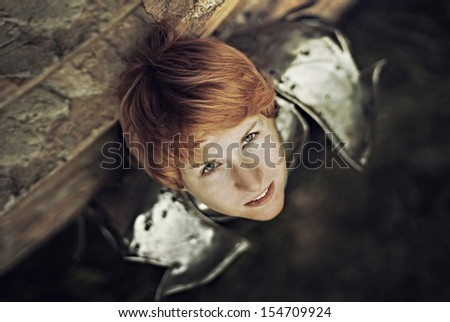 Portrait of a medieval female knight in armour outdoor - stock photo