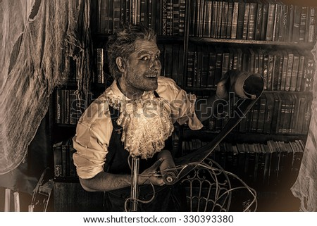 Portrait of a medieval scientist working in his laboratory. Alchemist. Halloween. Sepia. - stock photo