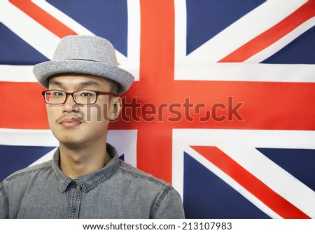 Portrait of a mid adult man against British flag