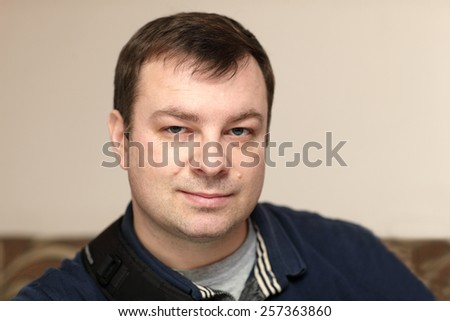 Portrait of a mid adult man indoor - stock photo