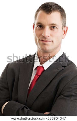 Portrait of a mid 30s businessman wearing suit and tie isolated on a white background