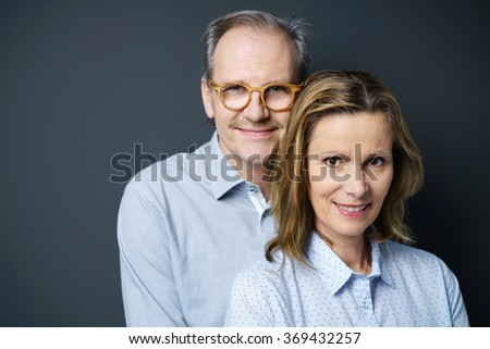 portrait of a middle-aged couple standing close together