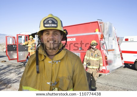 Portrait of a middle aged hispanic firefighter - stock photo