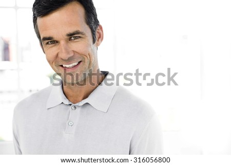 Portrait of a middle-aged man - stock photo