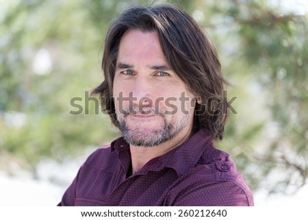 Portrait of a middle aged man in nature - stock photo