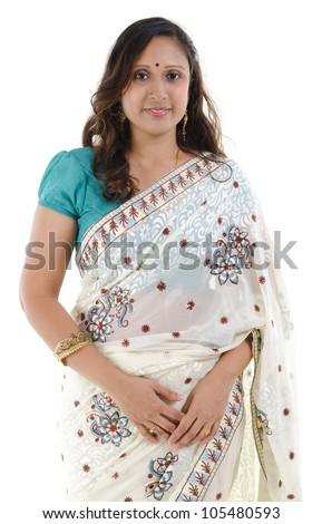 Portrait of a middle aged Traditional Indian woman in sari costume isolated on white background