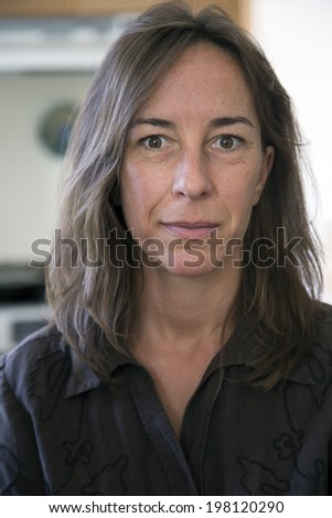 Portrait of a middle aged woman looking a little sad. - stock photo