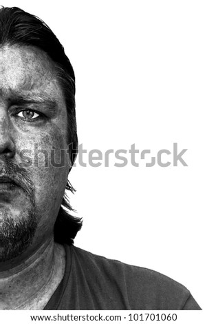 Portrait of a mine worker with a dirty face - stock photo