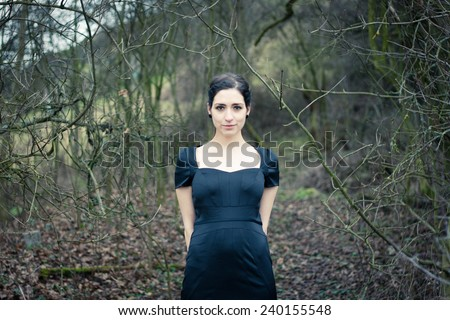 Portrait of a mischievous pretty girl - stock photo