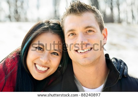 Portrait of a mixed race couple outside in the snow