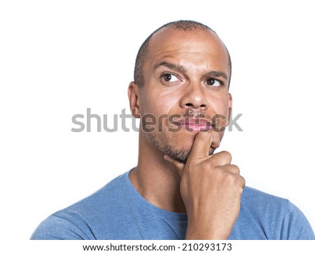 Portrait of a mixed race man concentrating and thinking about something with his hand on his chin