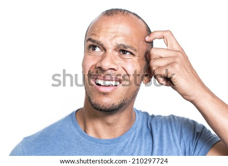 Portrait of a mixed race man expression confusion or misunderstanding whilst scratching his head - stock photo