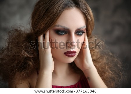 Portrait of a model with fashion fairstyle - stock photo