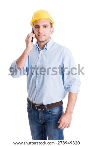 Portrait of a modern engineer talking on smartphone isolated on white studio background
