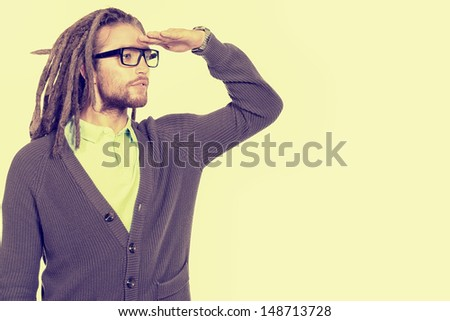 Portrait of a modern handsome young man in spectacles looking into the distance. Isolated over white. - stock photo