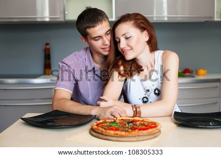 Portrait of a Modern romantic couple preparing a meal