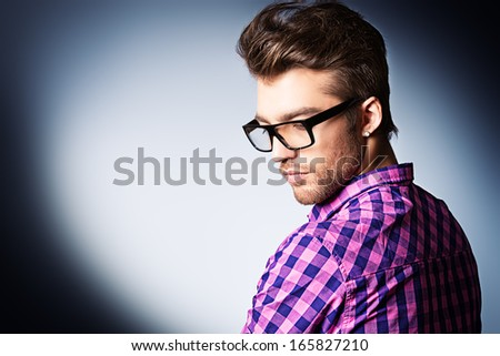 Portrait of a modern young man in spectacles. - stock photo