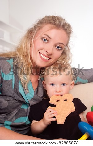 portrait of a mom with her daughter - stock photo