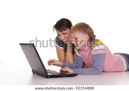 portrait of a mom with kid at laptop