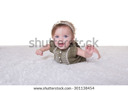 Portrait of a 6 month old baby girl - stock photo