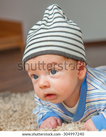 Portrait of a 2 months old baby boy at his home.