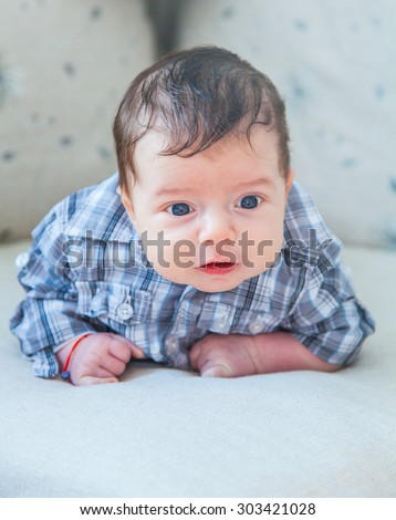 Portrait of a 2 months old baby boy at home. - stock photo