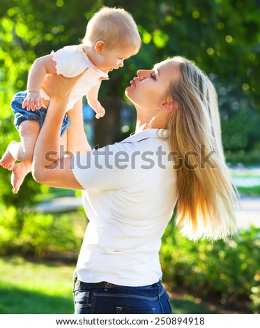 Portrait of a mother and her baby enjoy the summer sunset - stock photo