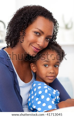Portrait of a mother and her little girl at home - stock photo