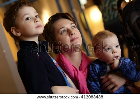 Portrait of a mother and her sons in museum - stock photo