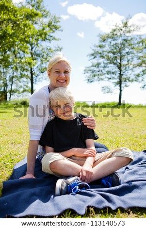 Portrait of a mother and son outdoors on a beautiful summer day