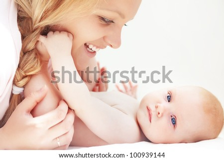 Portrait of a mother with her little baby - stock photo