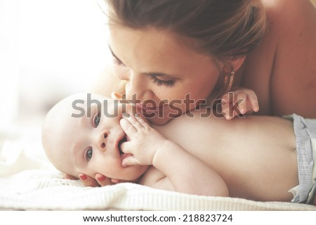 Portrait of a mother with her 3 monthes old baby - stock photo