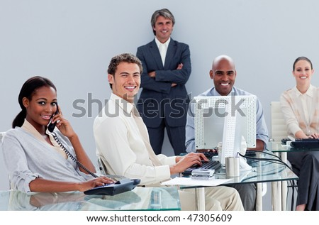 Portrait of a multi-ethnic business team at work  in the office - stock photo