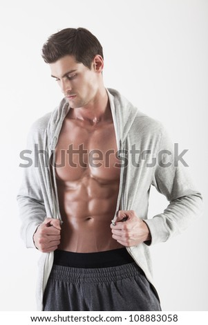 Portrait of a muscle man posing in studio isolated - stock photo