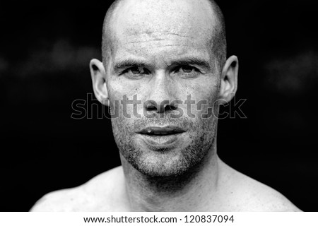 Portrait of a muscular athlete with sweat after exercise - stock photo