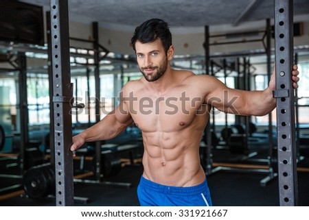 Portrait of a muscular man resting in fitness gym